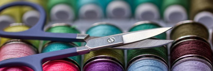 scissors and spools of thread